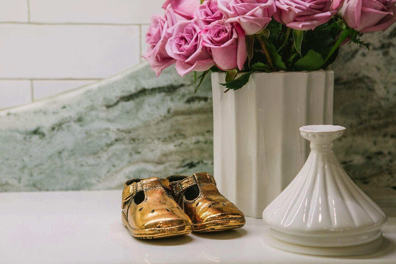 I cherish my daughter Liza's bronze-dipped baby shoes